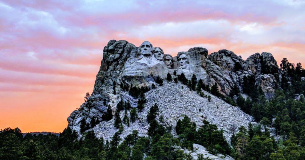 travel to view Mt. Rushmore in South Dakota