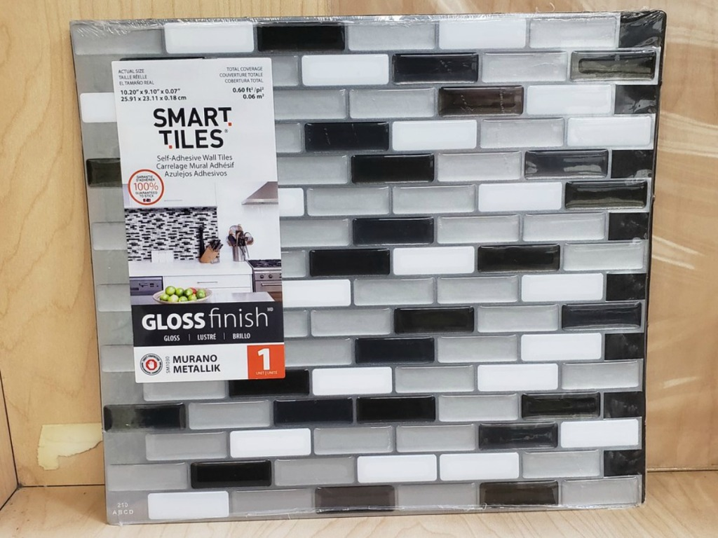 tile leaning against wall with grey and black