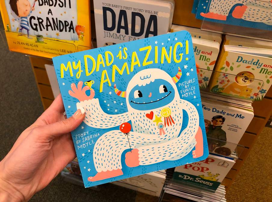 Woman holding My Dad Is Amazing Board Book