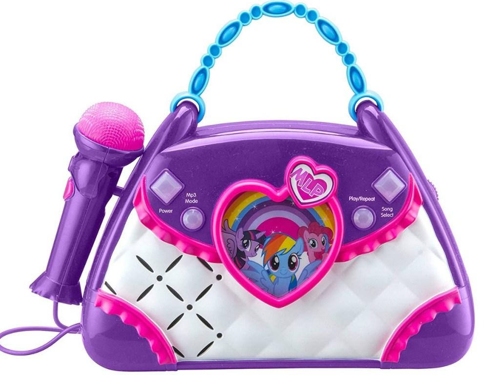 purple boombox shaped like a purse with a microphone