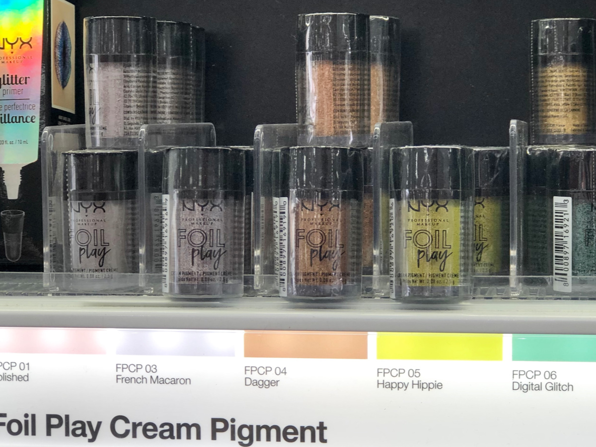 NYX Foil Play Eyeshadow containers on a Target shelf