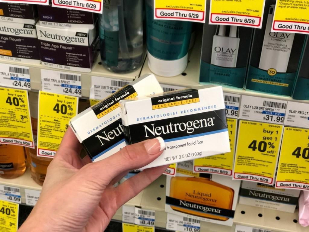 hand holding two neutrogena bars