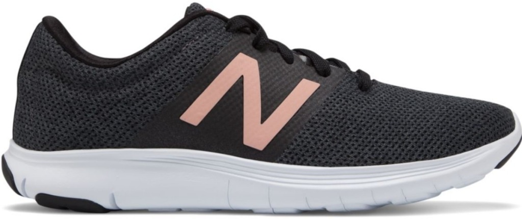 New Balance women's black running shoes with rose gold N decal on side