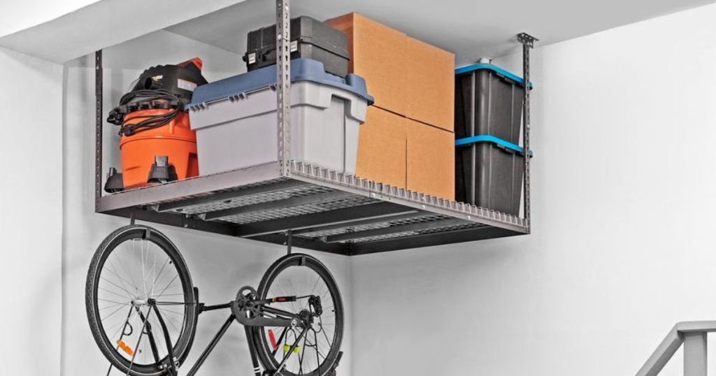 NewAge Products VersaRac with boxes, totes, and shop vac on rack with bike hanging from hook