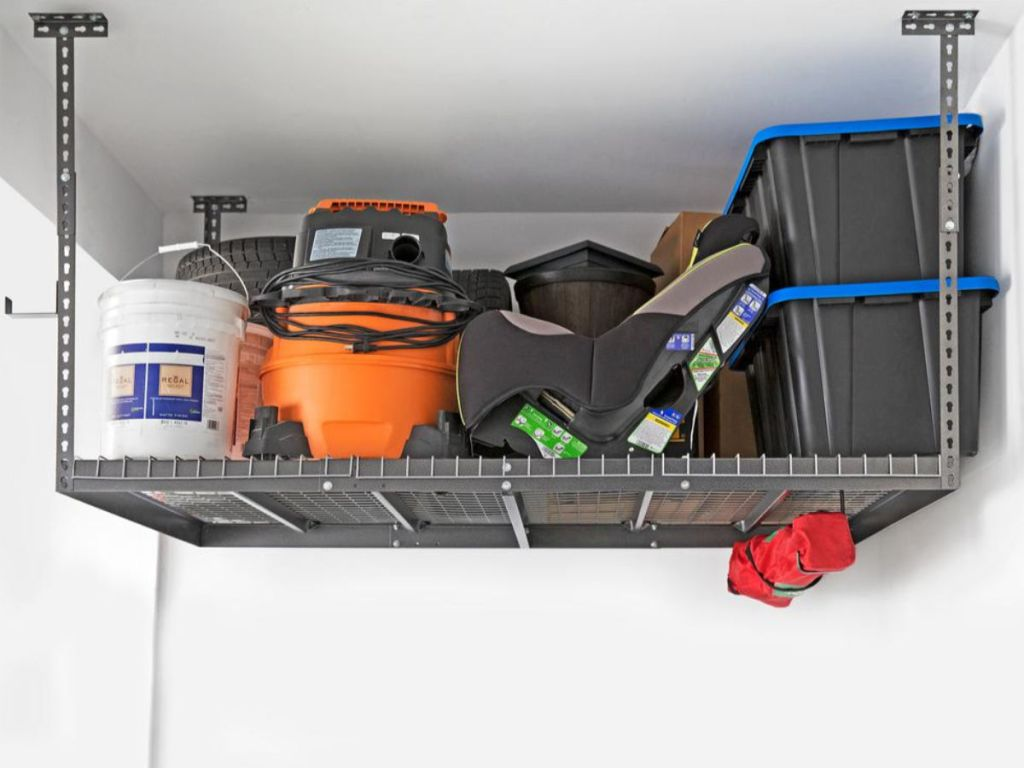 newage garage ceiling shelf holding carseat, storage totes, shop vac, tent and more