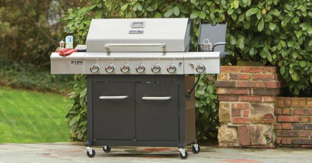 large silver and black Nexgrill 6-burner grill sitting in picturesque back yard
