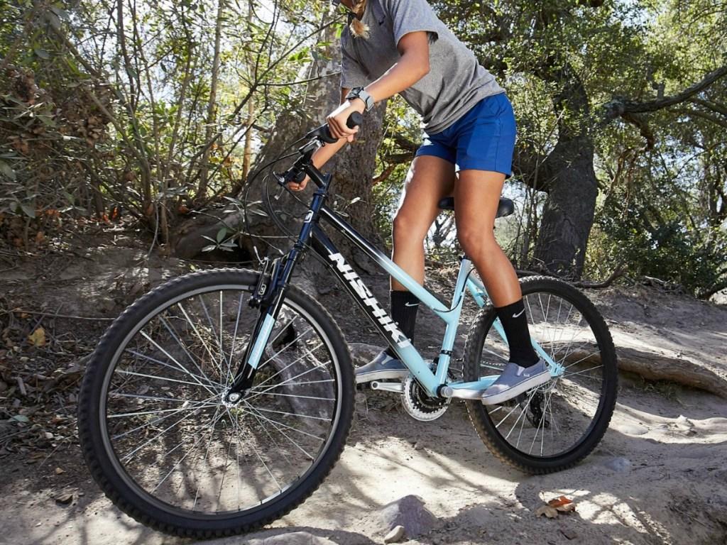 woman riding Nishiki Women's Pueblo 26'' Mountain Bike in great outdoors