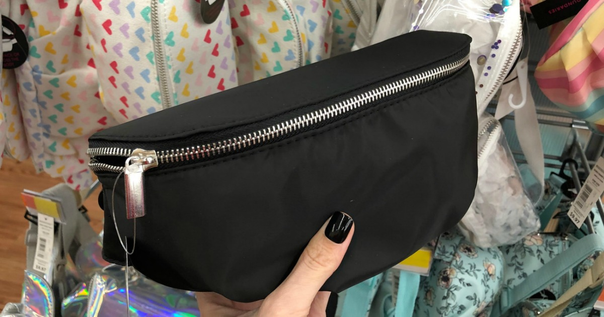 black fanny pack with silver zipper in store