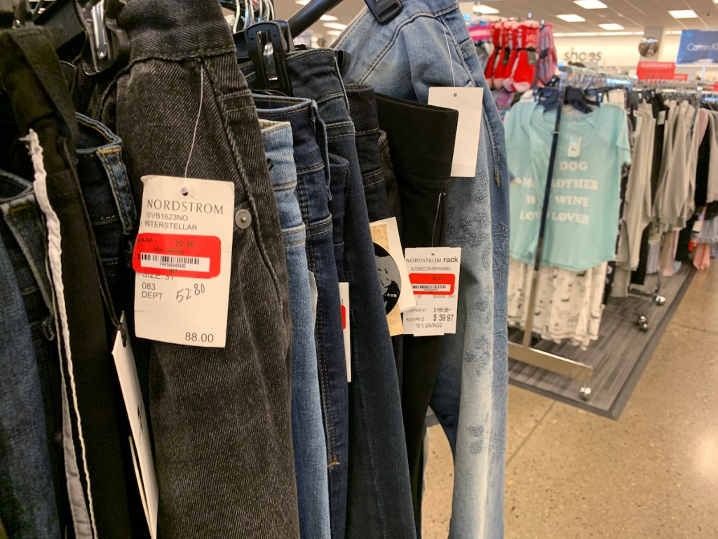 jeans hanging up on clothing rack