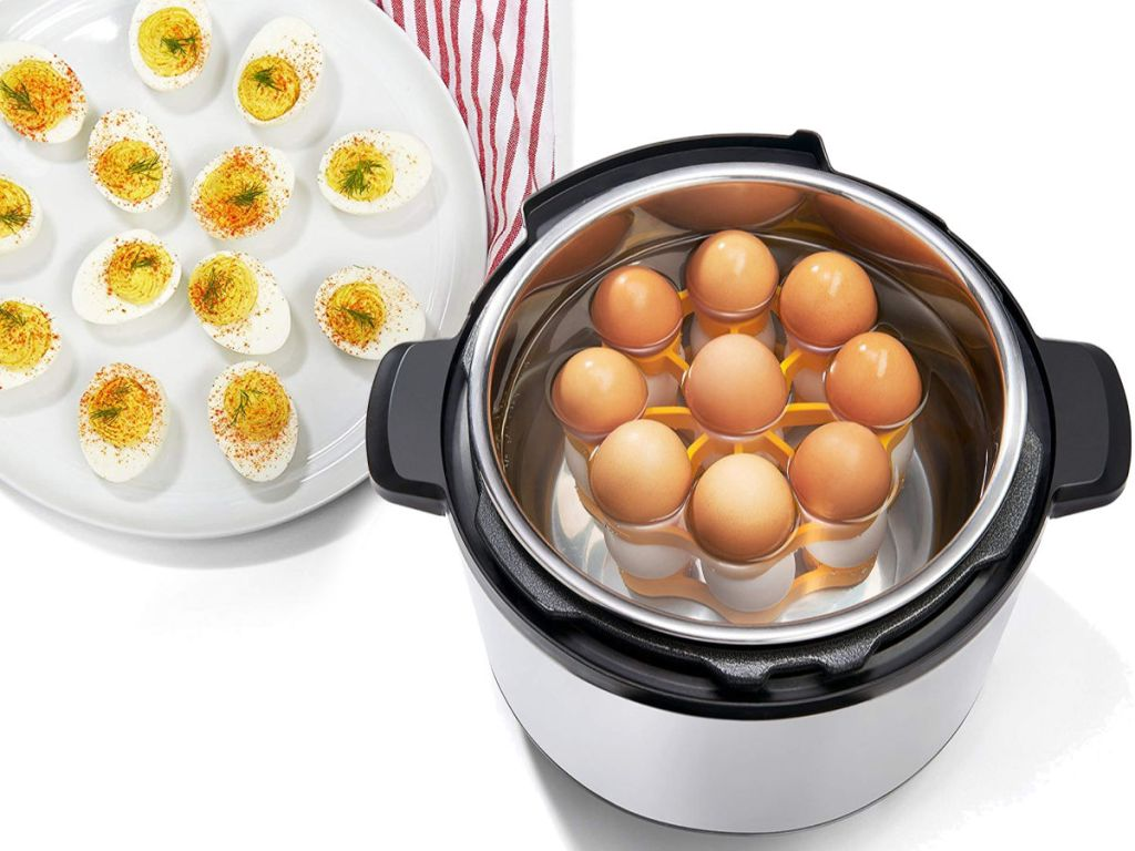 eggs being cooked in pressure cooker and deviled eggs on the side with OXO Silicone Pressure Cooker Egg Rack