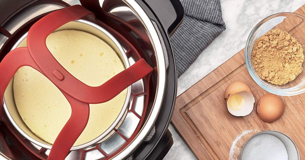 Cheesecake being cooked in pressure cooker with OXO Silicone Pressure Cooker Sling