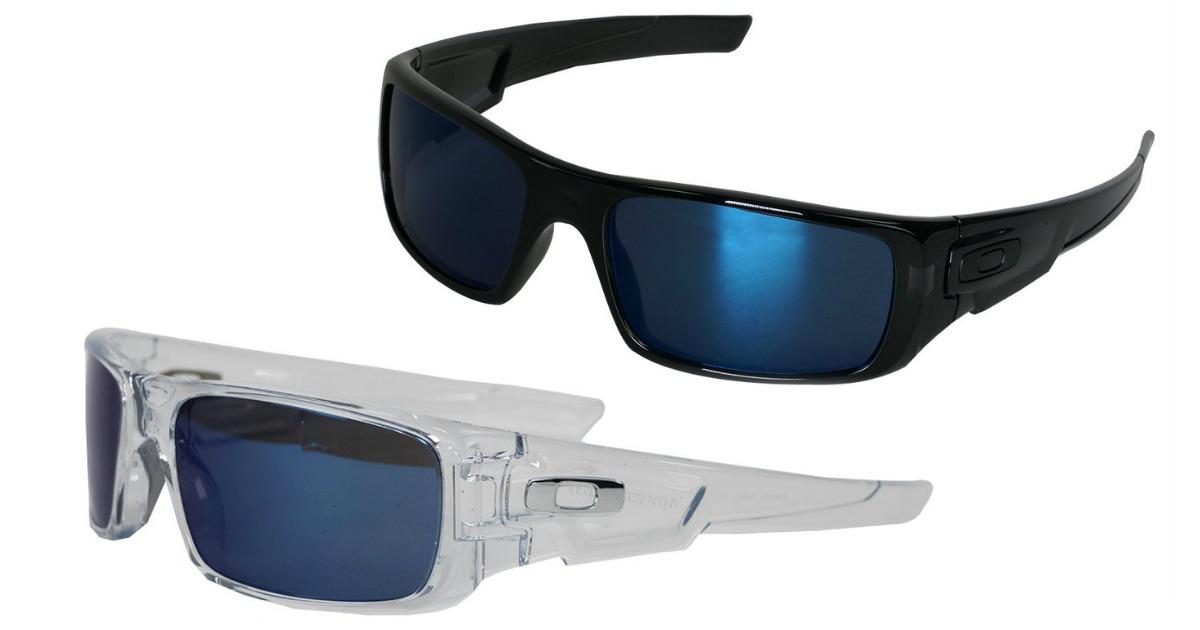 Black Oakley sunglasses with blue lenses above silver/white Oakleys with dark lenses