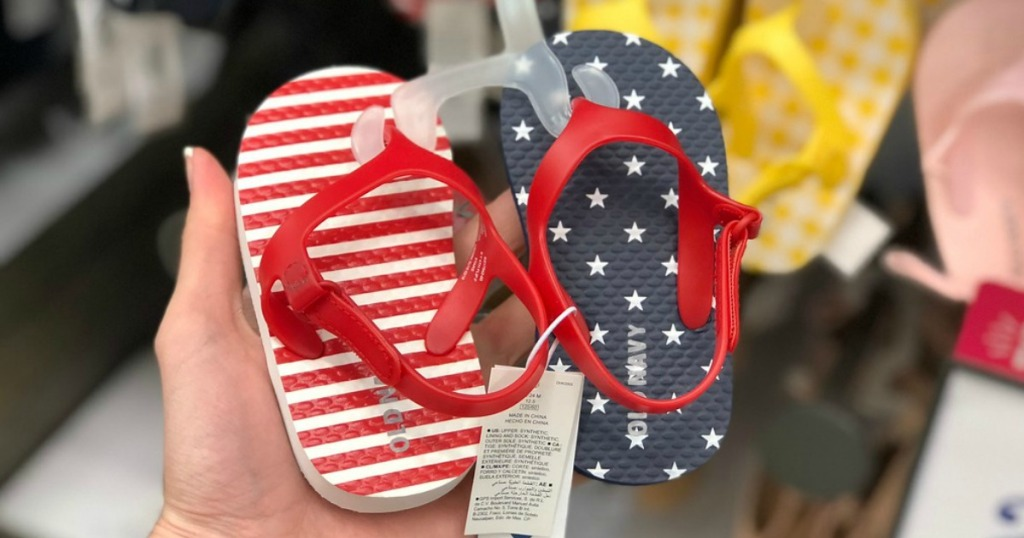 lady holding American Flag Baby Flip Flops at Old Navy