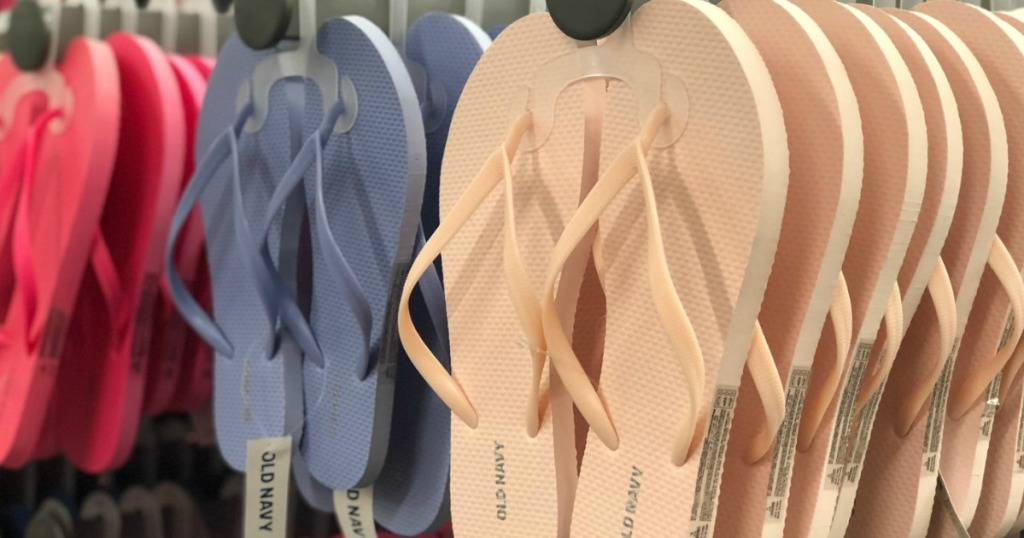 Pairs of flip flops on rack at Old Navy store