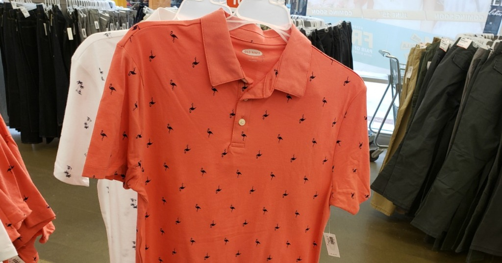 Old Navy Flamingo Polo for Men hanging inside Old Navy store