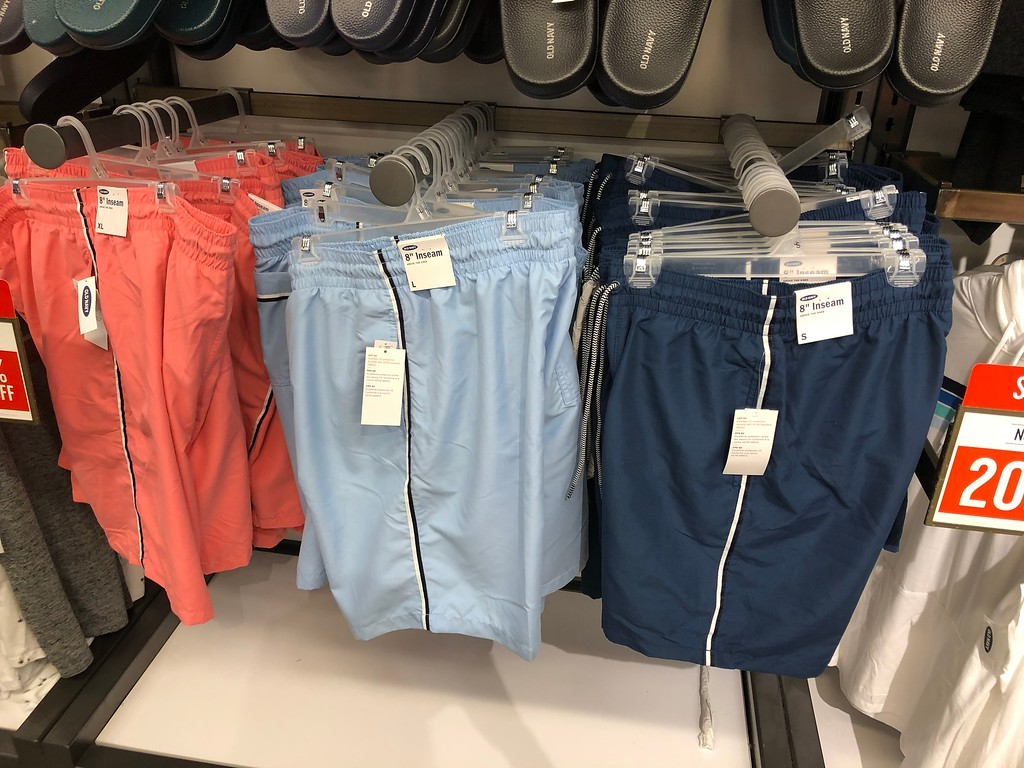 Old Navy Men's Swim Trunks hanging up in the store