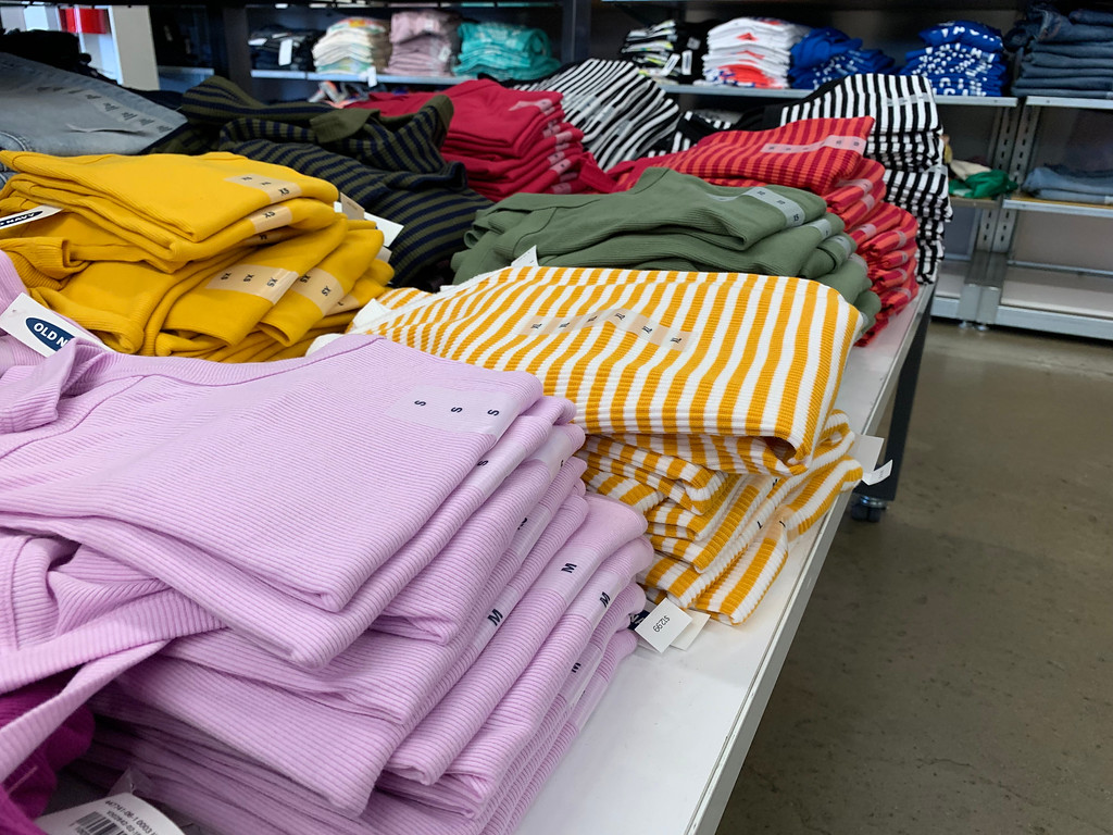 Old Navy Women's Tanks folded on a table at the store