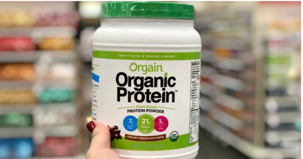 Orgain Organic Protein Being Held By a Woman's Hand