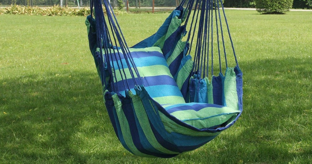 striped hammock chair hanging outside