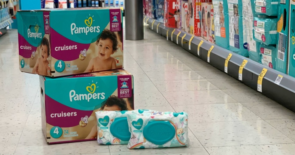2 Boxes of Pampers Cruisers & Pampers Wipes stacked on floor at Walgreens