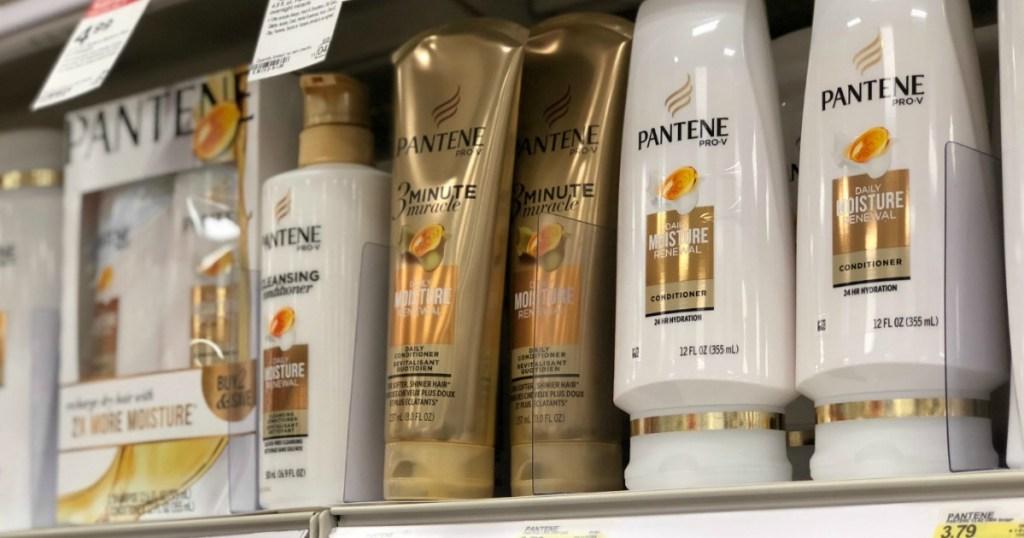 white and gold shampoo bottles on shelf