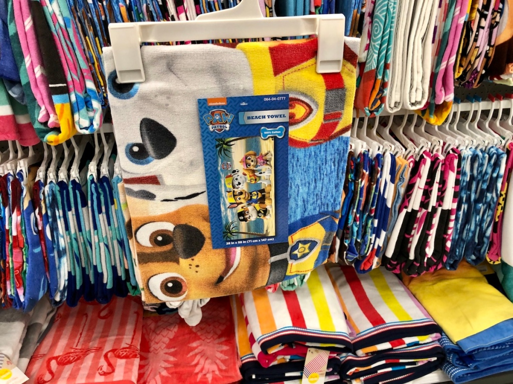 Paw Patrol beach towel on hanger in front of other towels