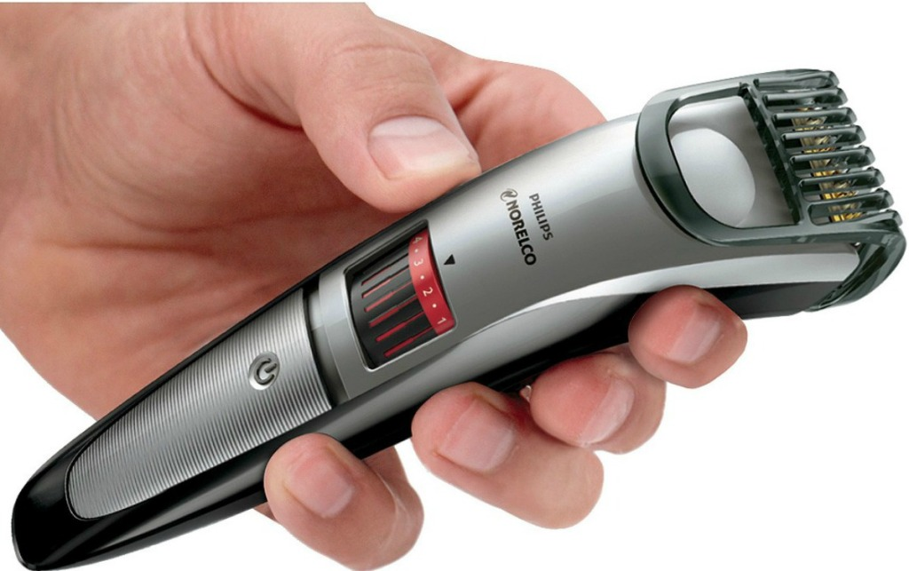 hand holding Philips norelco beard trimmer