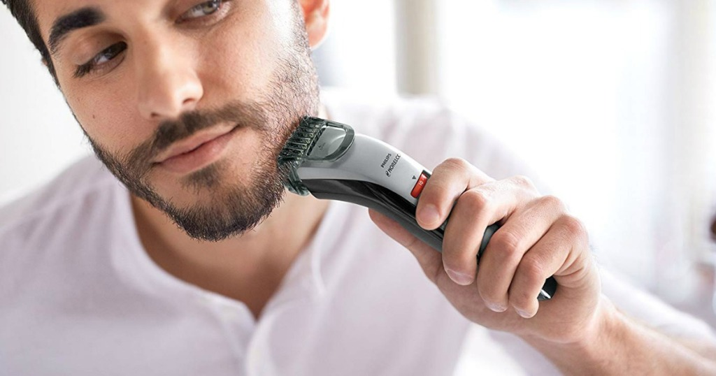 guy using the a philips norelco beard trimmer