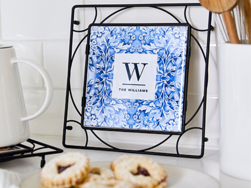 Custom photo trivet in kitchen with cookies and tea kettle