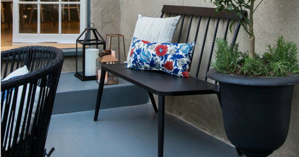 Metal loveseat bench on a patio
