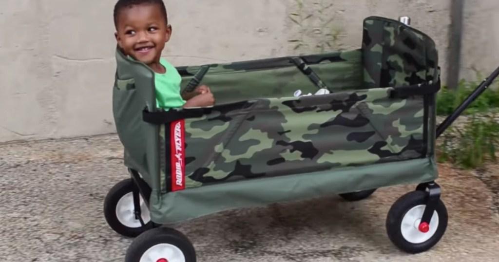 child riding in Radio Flyer wagon