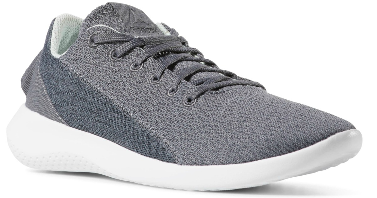 gray women's Reebok training shoes with white sole