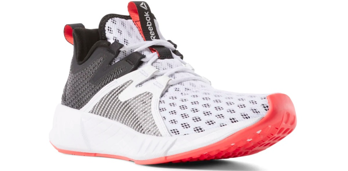 white Reebok running shoes wth black heel and red sole