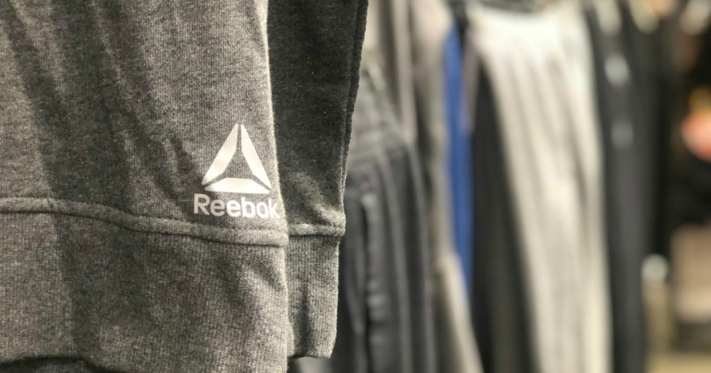 Reebok apparel hanging in store