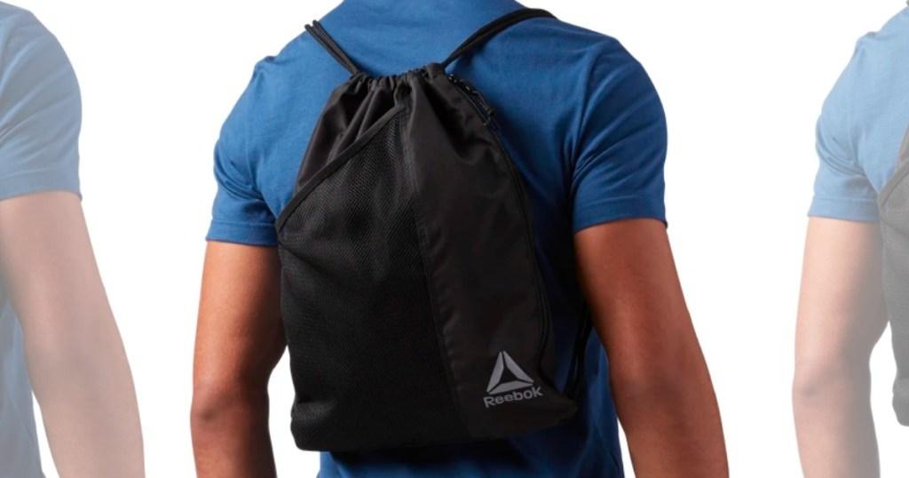 person wearing Reebok gymsack