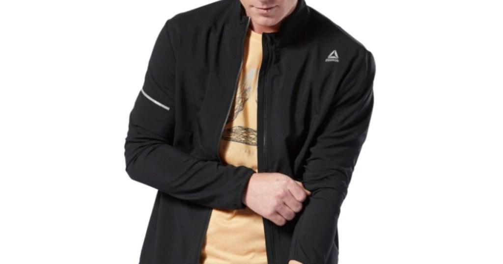 man wearing black reebok jacket