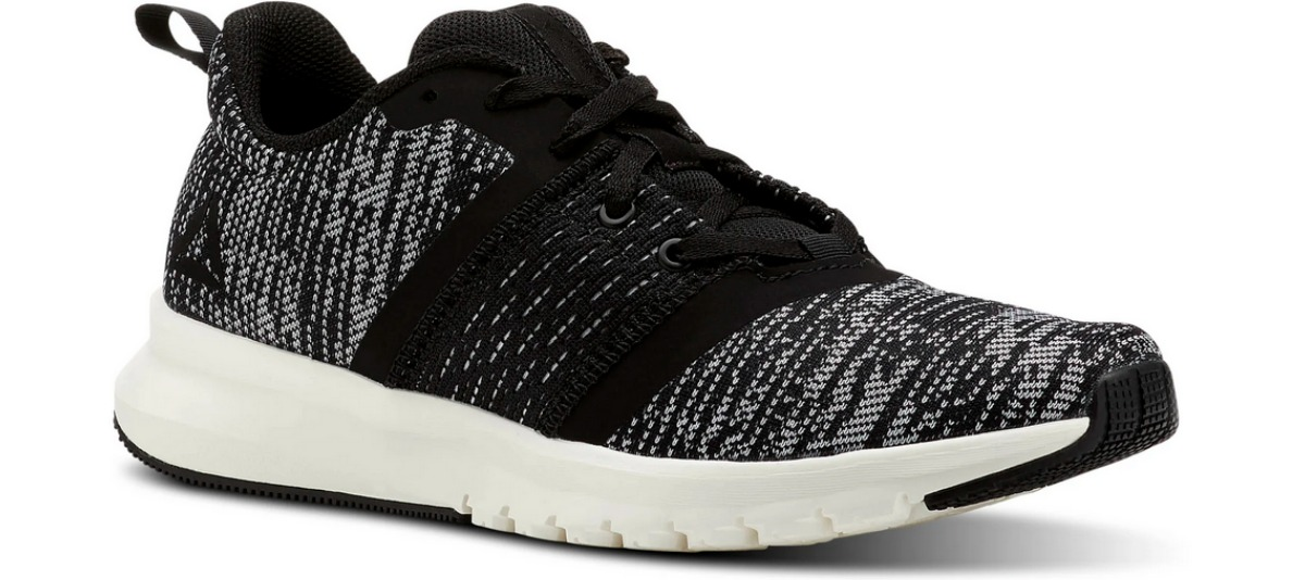 speckled black and gray Reebok running shoes