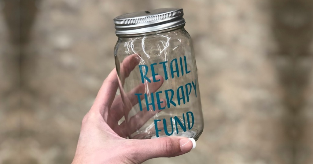 Woman holding Retail Therapy Fund Mason Jar