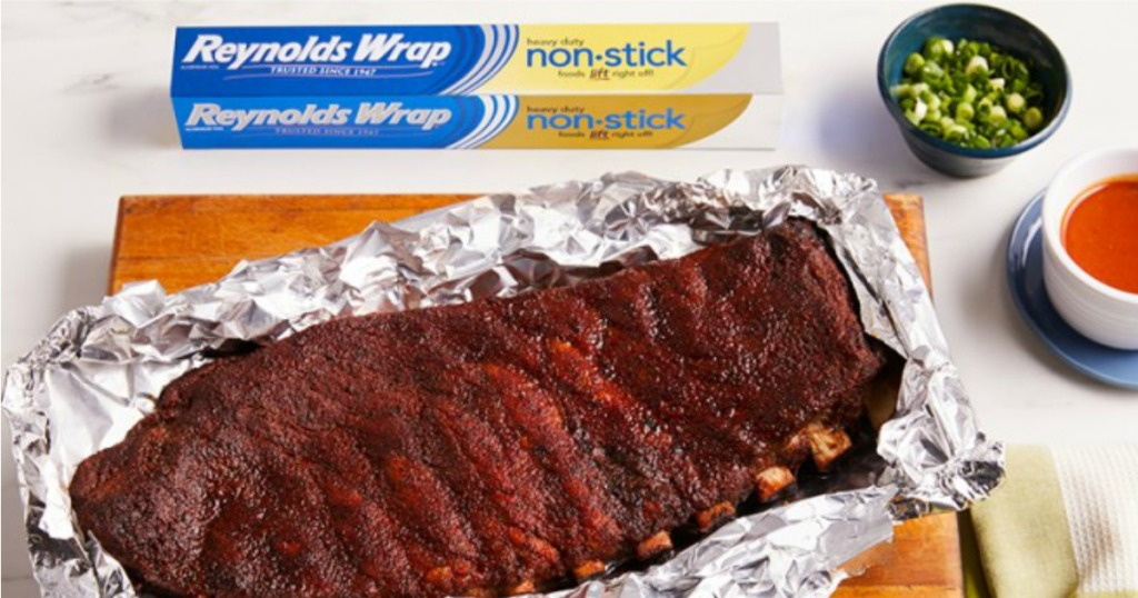 rack of ribs laid out on foil with box of foil next to it