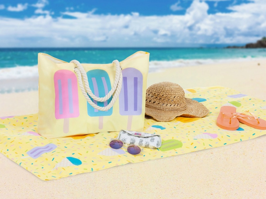 popsicle beach towel on the beach with a matching popsicle tote