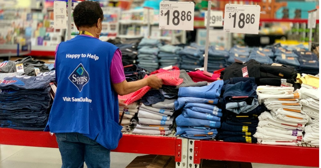 Female Sam's Club Employee arranging apparel items