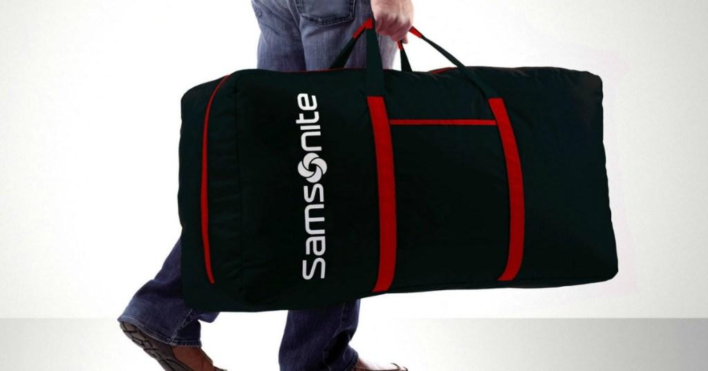 person holding Samsonite Duffel Bag