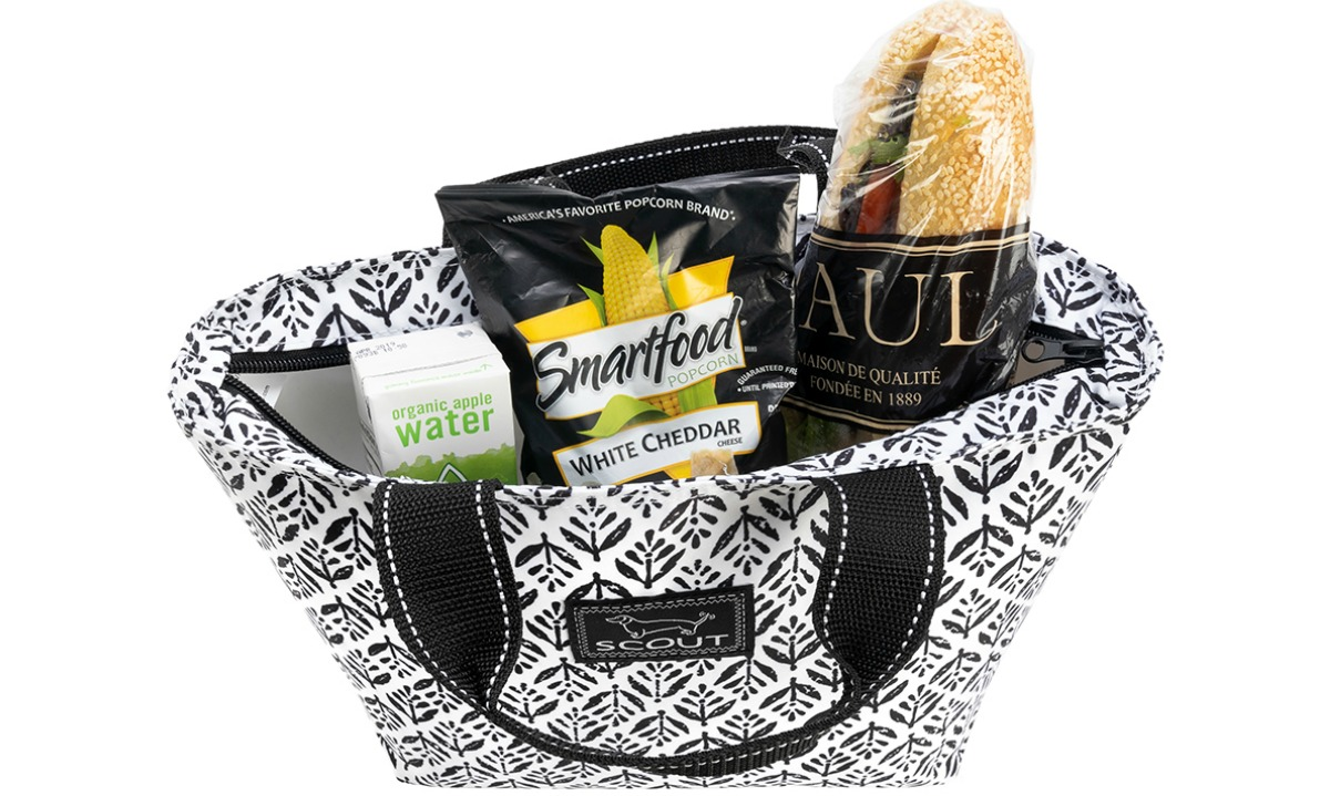 black and white patterned lunch tote filled with snacks