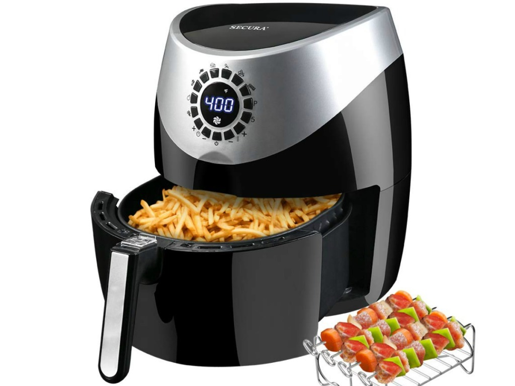 Secura air fryer with bucket pulled out filled with fries and veggies skewers on the side