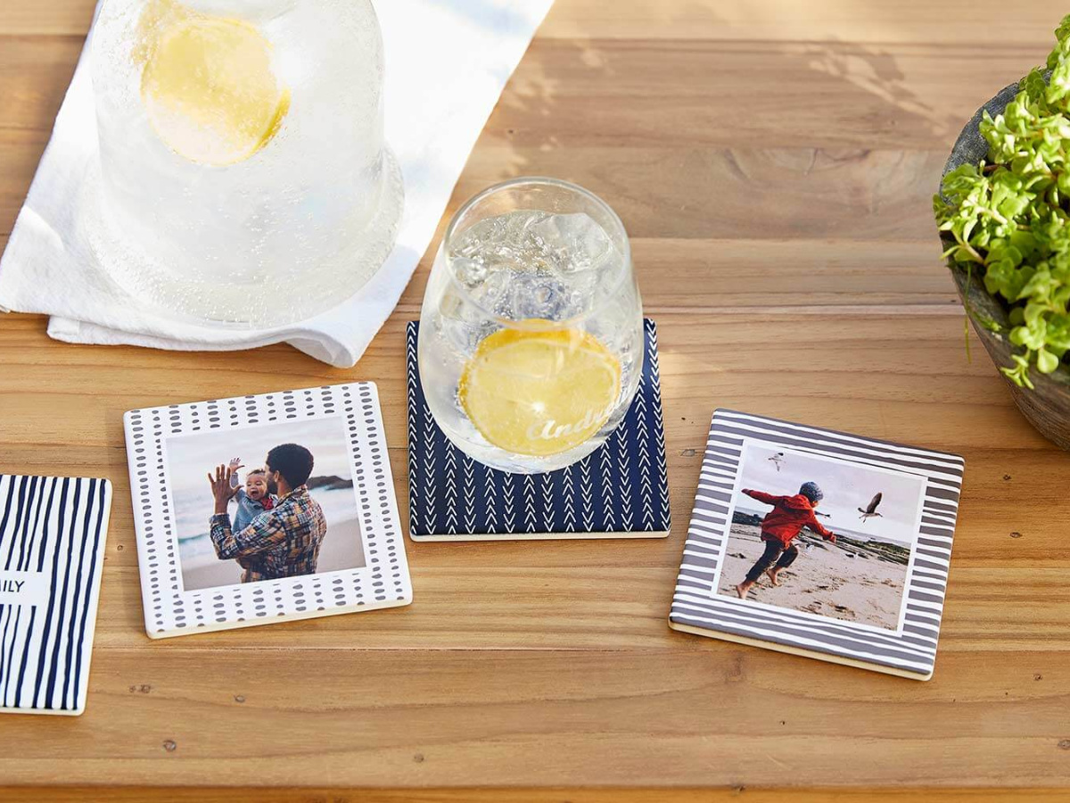 Shutterfly coasters of families and glass of water with lemon
