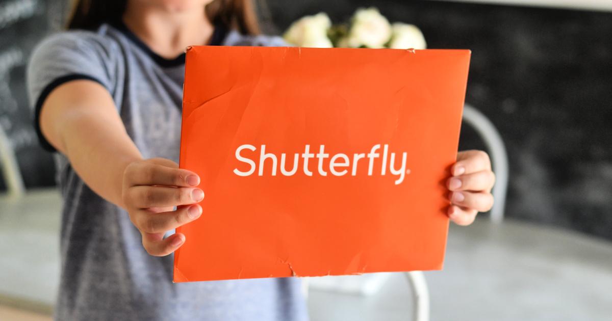 girl holding shutterfly envelope