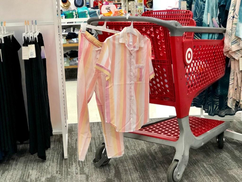Striped women's pajamas hanging on cart