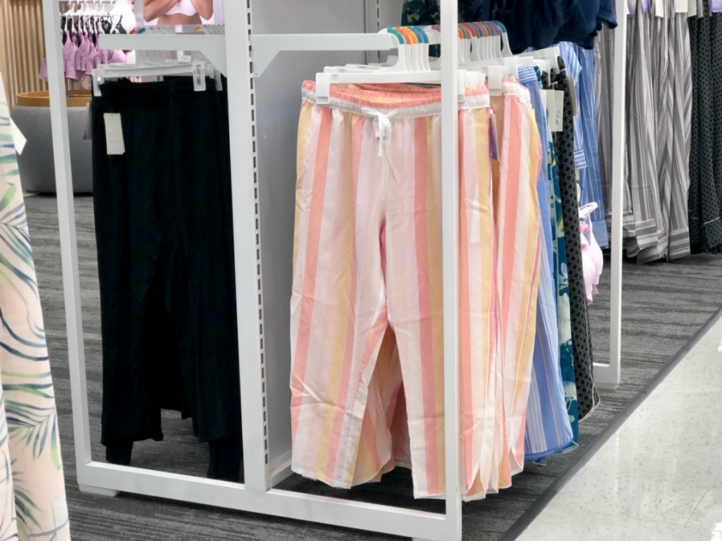 simply cool pajama bottoms hanging on rods at Target