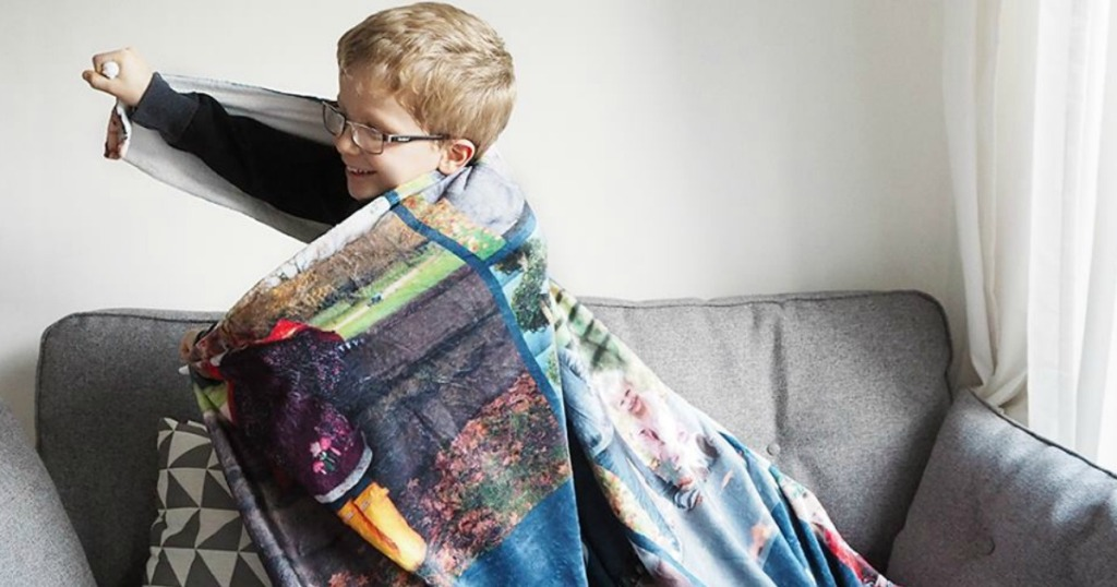 Young boy wrapped in a personalized photo blanket
