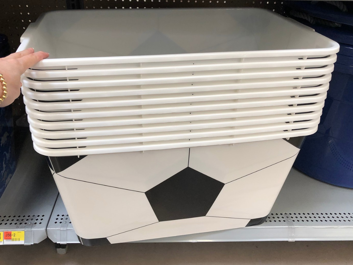 black and white plastic totes with soccer ball pattern on a store shelf